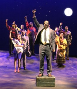 CLOCKWISE: George Bwanika Seremba, Stephen Jennings, Karim Morgan, Sidongile Nene, Nehassaiu deGannes, Xuan Fraser, Ngozi Paul, Andrew Moodie and Mxogili Welcome Ngozi in a scene from In the Freedom of Dreams: The History of Nelson Mandela (2003); Set & Costume Design by Julia Tribe, Lighting Design by Andrea Lundy; Photo by Tom Sandler